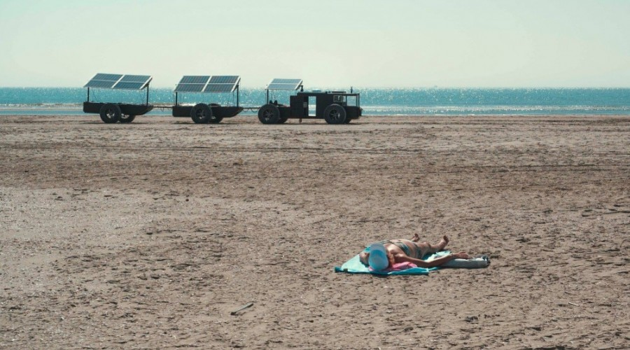 Burning sand, lukewarm seawater and people in airy swimsuits; a complete different atmosphere than we're preparing for at Clean2 Antarctica. On a tropical summerday on the wide beach of IJmuiden people were startled by a strange vehicle: the Solar Voyager.